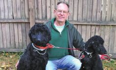 Pictured with his dogs, Lucy and Henry, Mark Vail has rekindled his former talent as a master potter.