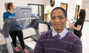 Damon Swift, Ph.D. (pictured with patients), studies physical activity and weight management.
