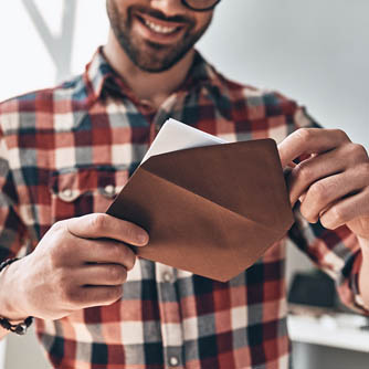 a man receives a greeting card